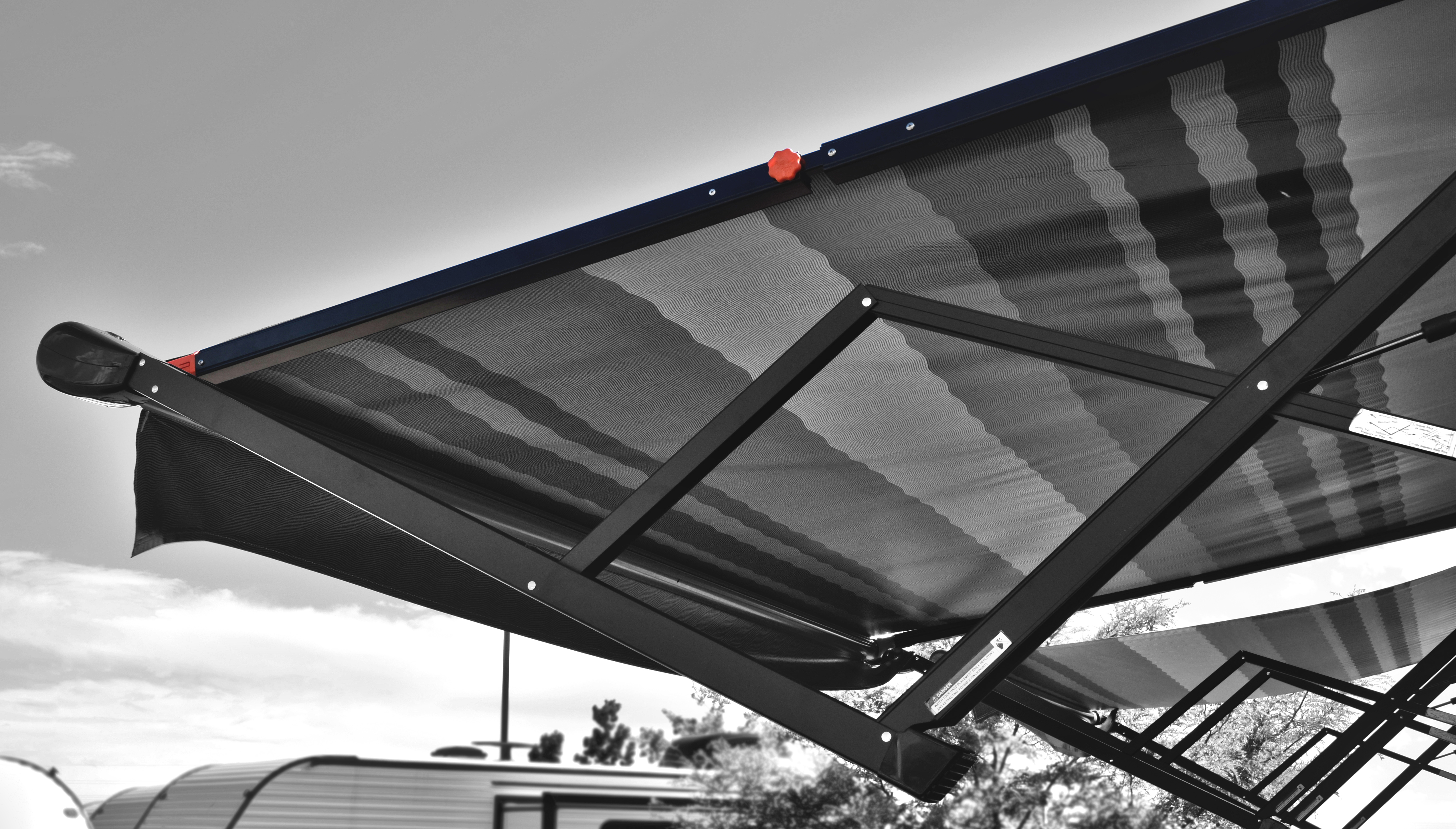 Anti-Flap Kit in black and white on a RV awning